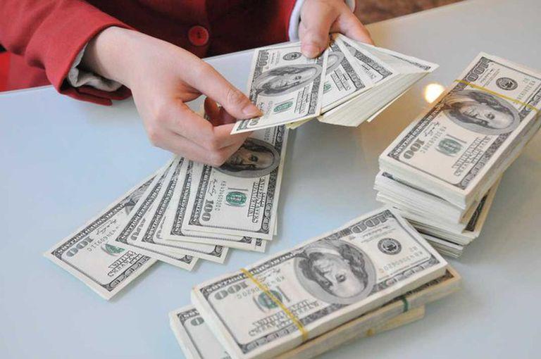 Tỷ giá USD hôm nay 13/4: Giao dịch ở mức đáy hai tuần - 1