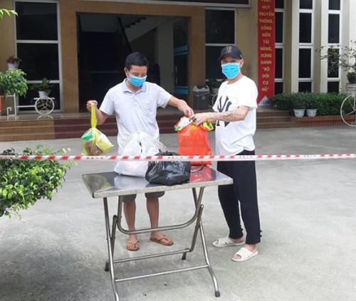 Hai người trở về từ Nhật Bản dương tính với SARS-CoV-2 - 1