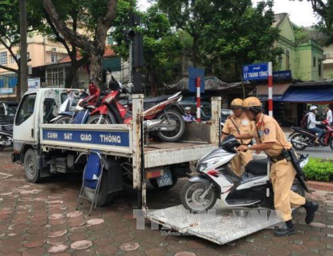 Mắc những lỗi này, lái xe máy sẽ bị tạm giữ ngay phương tiện - 1