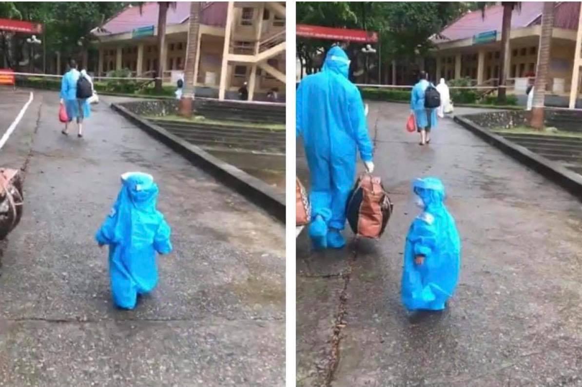 Clip bé trai 3 tuổi bị ung thư trong bộ đồ bảo hộ lon ton bước theo bố gây xúc động - 1