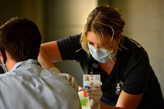 Nơi đứng đầu thế giới về tiêm vaccine đánh bại Covid-19 - 1