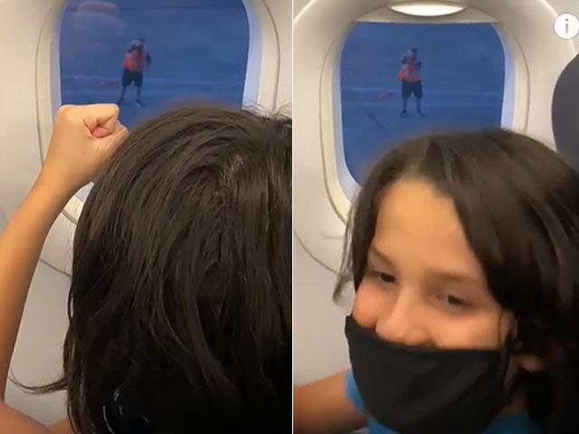 Clip: Nhân viên sân bay có hành động khiến cậu bé vô cùng phấn khích - 1