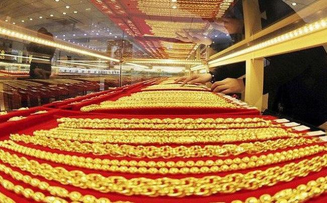 Giá vàng hôm nay 29/9: Dân buôn bán tháo, vàng giảm giá chóng mặt - 1